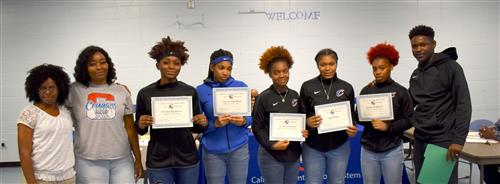 Girls Basketball team with certificates